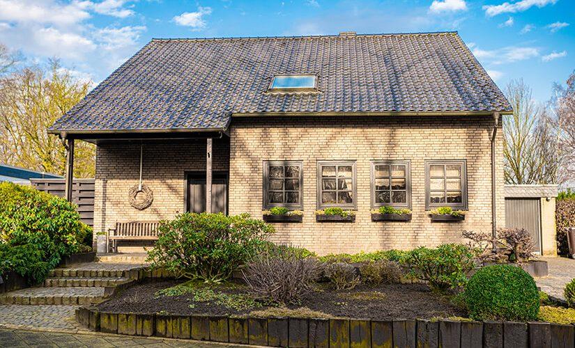 ESTIMER-facade-of-luxury-detached-house-with-beautiful-gar-GLF2TNK