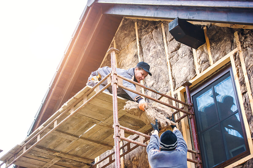 construction-workers-thermally-insulating-house