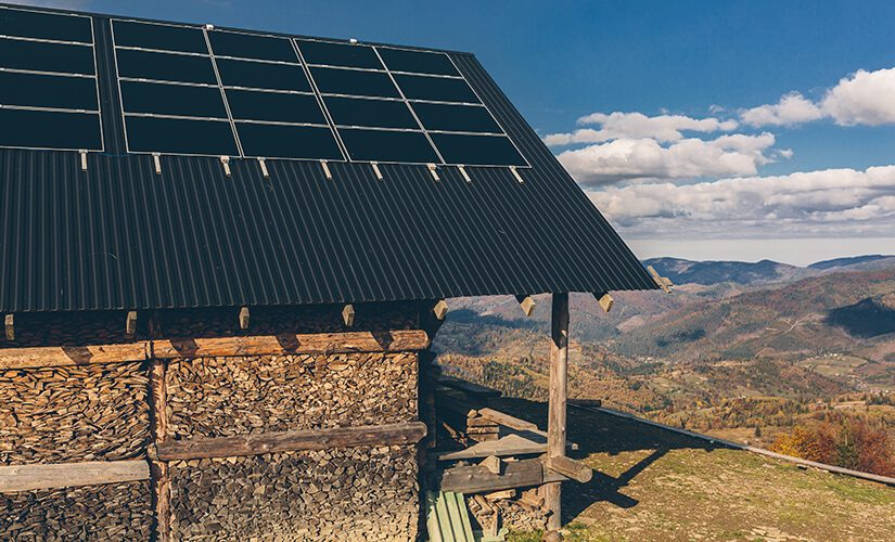 photo-of-house-in-the-mountains-on-the-roof-of-solar-panel-sunset